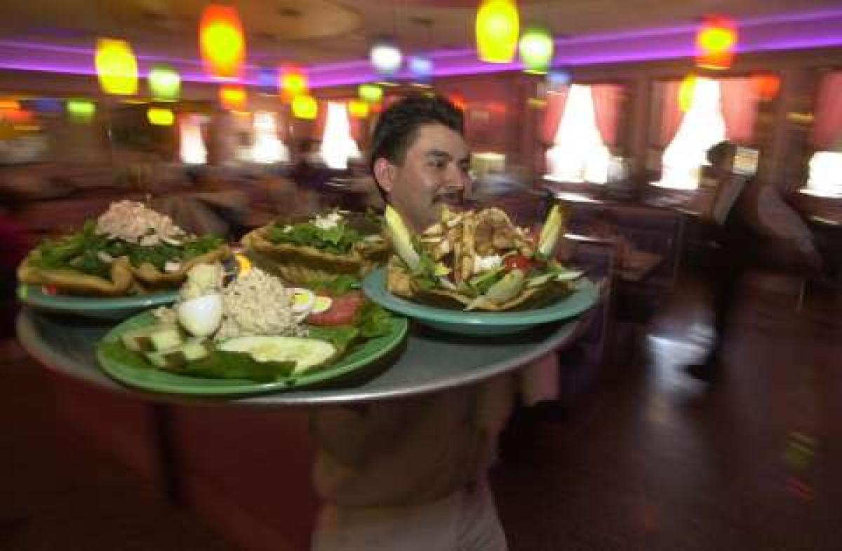 A waiter at a Bronx restaurant. . (KEITH D. BEDFORD/NEW YORK DAILY NEWS)